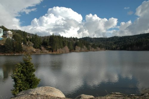 Lake Gregory is a scenic alpine lake in the San Bernardino Mountains of Southern California. Swimming, boating, fishing, waterslides and beaches may be found here.